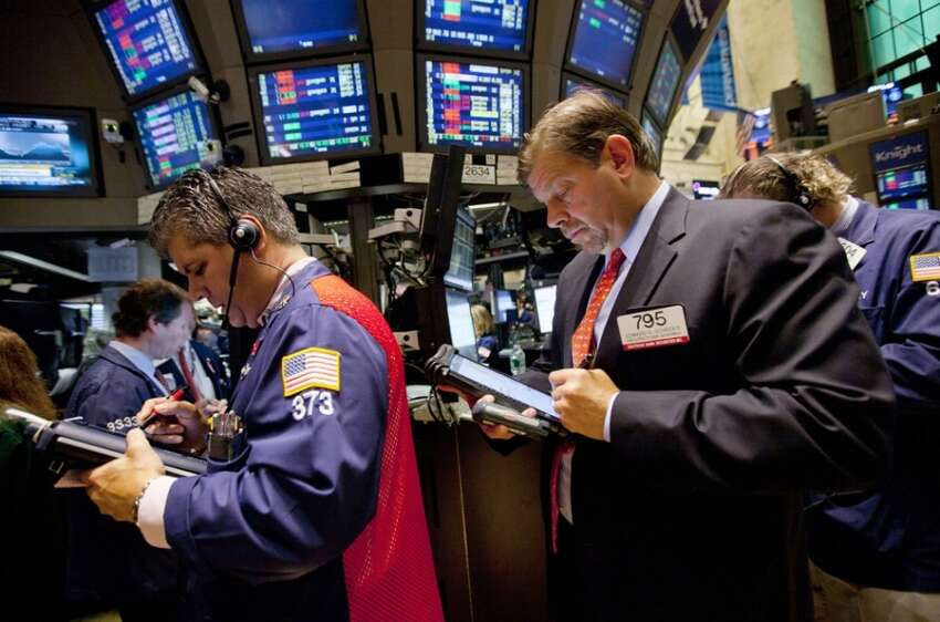 Traders work on the floor of the New York Stock Exchange on Thursday, Aug. 4, 2011 in New York. (AP Photo/Jin Lee)