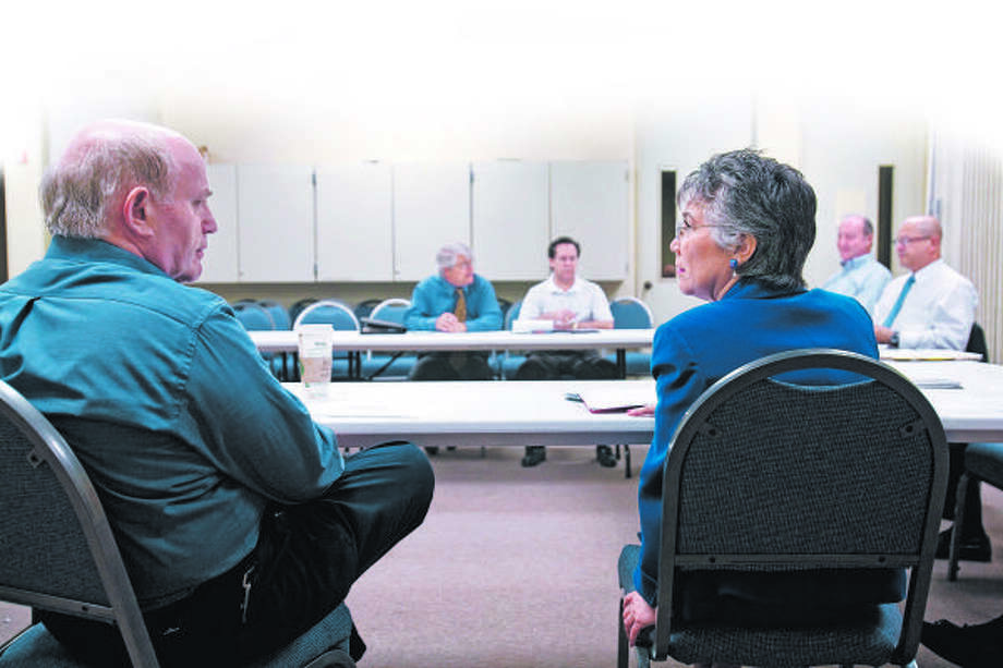 Jerry Greenbaum and Margaret Johnson talk about their job search experiences during a meeting of senior-level executives who have been laid off recently. The group, one of several in  Houston, offers executives support in their job searches. Photo: NATHAN LINDSTROM :, FOR THE CHRONICLE