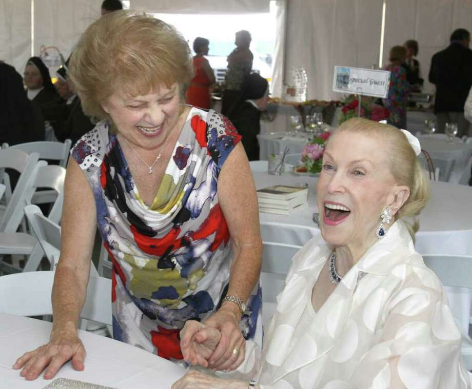 Saratoga Springs, NY - July 28, 2011 - (Photo by Joe Putrock/Special to the Times Union) - Janice Smircich(left) And Marylou Whitney(right) share a laugh during the Teresian House Foundation 21st Annual Friendraising Gala. Photo: Joe Putrock / Joe Putrock