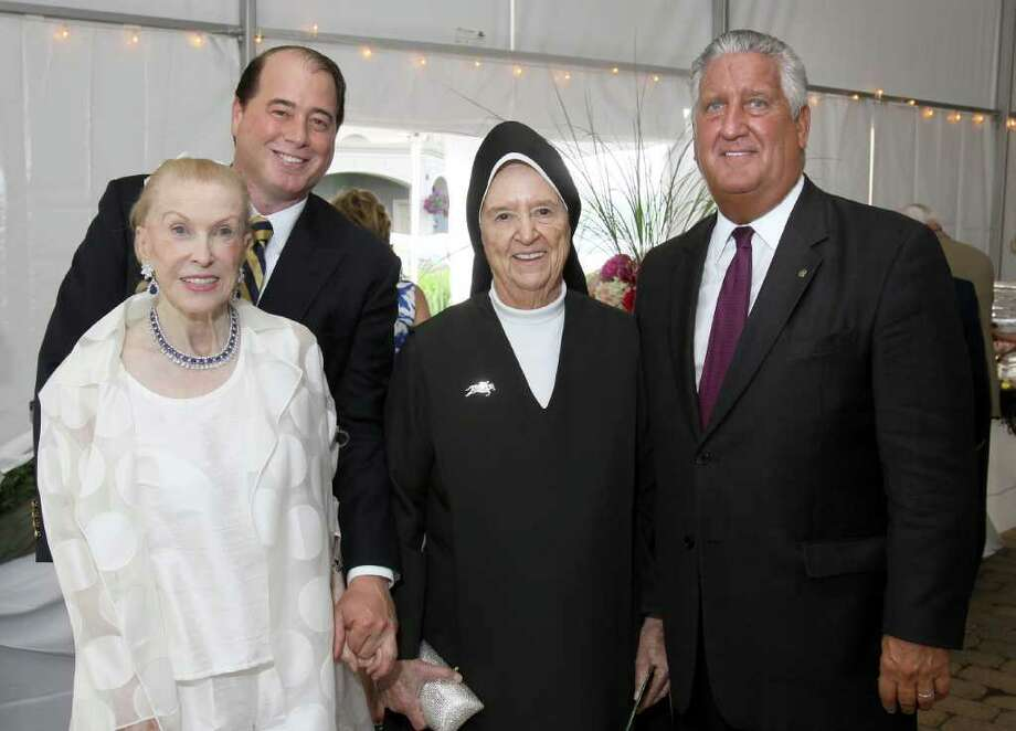 Saratoga Springs, NY - July 28, 2011 - (Photo by Joe Putrock/Special to the Times Union) - Administrator of Teresian House Sister Pauline Breccanier, O.Carm.(2nd from right) greets Marylou Whitney(left), her husband John Hendrickson(2nd from left) and Albany Mayor Jerry Jennings(right) during the Teresian House Foundation 21st Annual Friendraising Gala. Photo: Joe Putrock / Joe Putrock