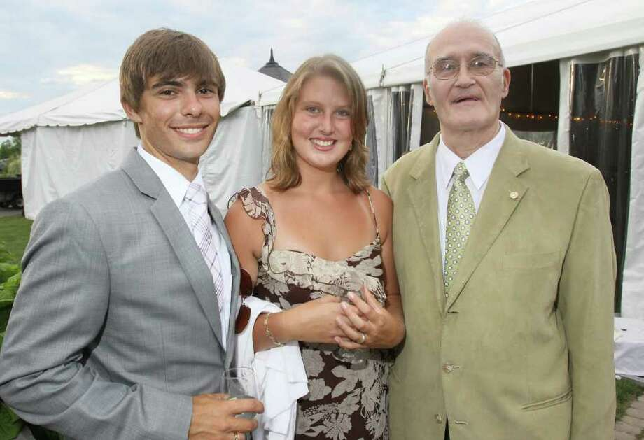 Saratoga Springs, NY - July 28, 2011 - (Photo by Joe Putrock/Special to the Times Union) - Helaina Stergas(center) poses with Tyler Hornidge(left) and his grandfather Edward Hornidge(right) during the Teresian House Foundation 21st Annual Friendraising Gala. Photo: Joe Putrock / Joe Putrock