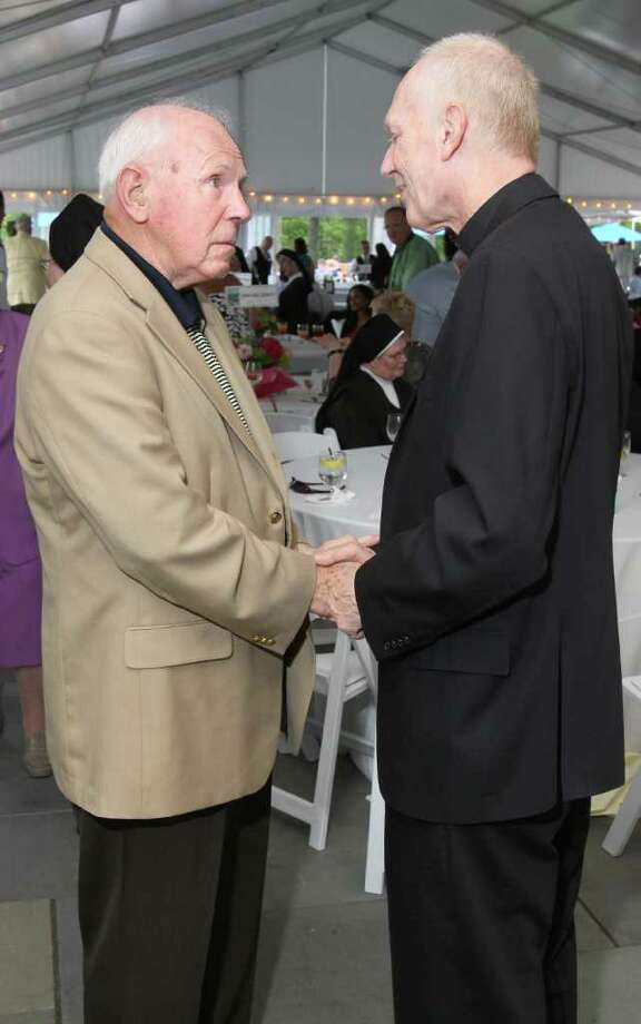 Saratoga Springs, NY - July 28, 2011 - (Photo by Joe Putrock/Special to the Times Union) - Raymond Butts(left) talks with Bishop of Albany Howard J. Hubbard(right) during the Teresian House Foundation 21st Annual Friendraising Gala. Photo: Joe Putrock / Joe Putrock