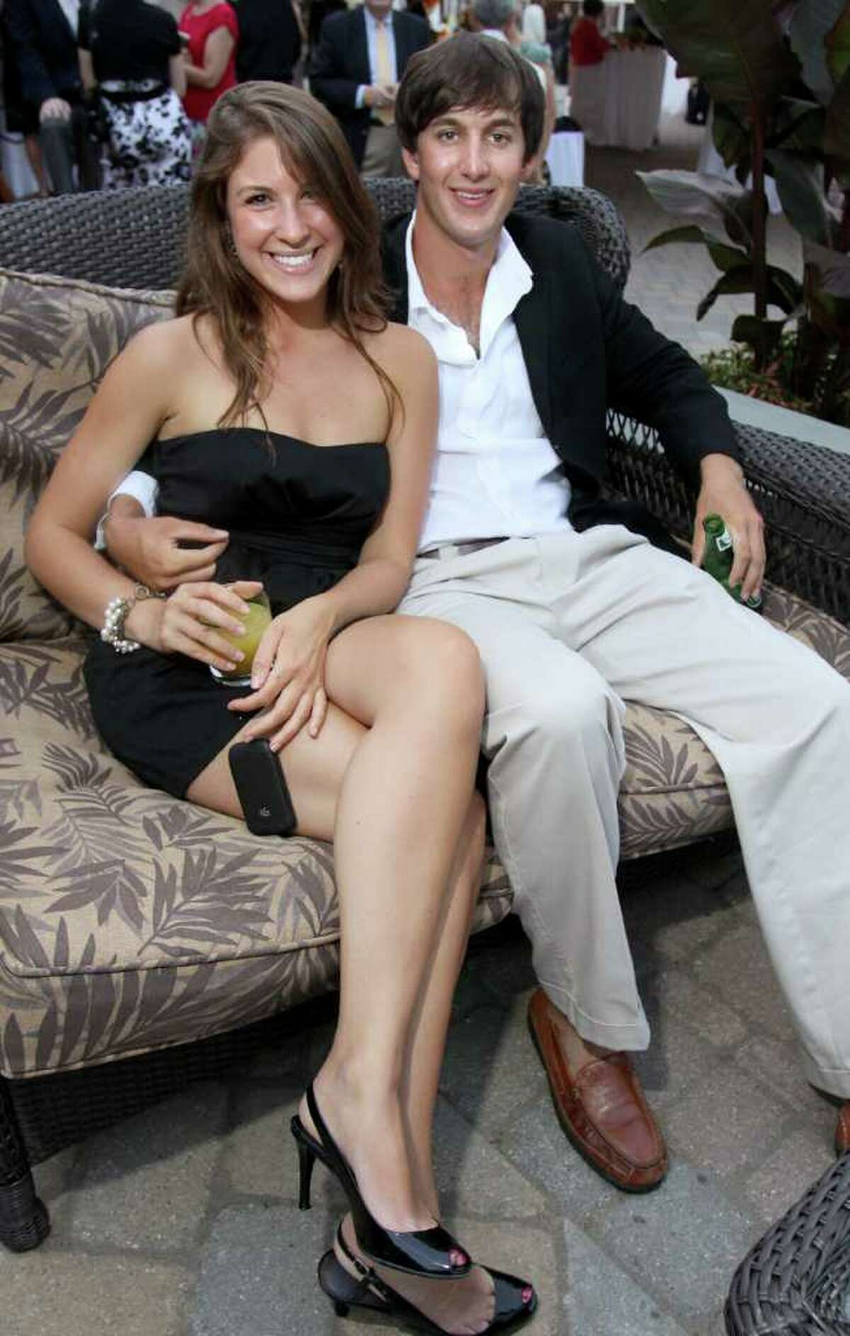 Saratoga Springs, NY - July 28, 2011 - (Photo by Joe Putrock/Special to the Times Union) - Lauren Betzwieser(left) and Alex Olbrych(right) relax on the patio of Saratoga National Golf Club during the Teresian House Foundation 21st Annual Friendraising Gala.