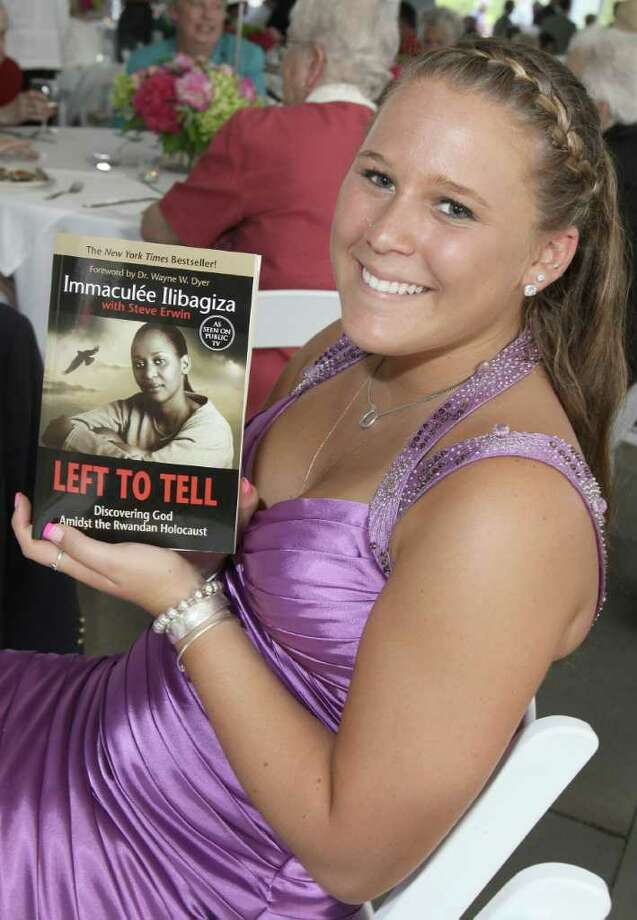 Saratoga Springs, NY - July 28, 2011 - (Photo by Joe Putrock/Special to the Times Union) - Erica DiMaria shows off her newly pruchased copy of the book Left to Tell, Discovering God Amidst the Rwandan Holocaust by Immaculee Ilibagiza during the Teresian House Foundation 21st Annual Friendraising Gala. Photo: Joe Putrock / Joe Putrock