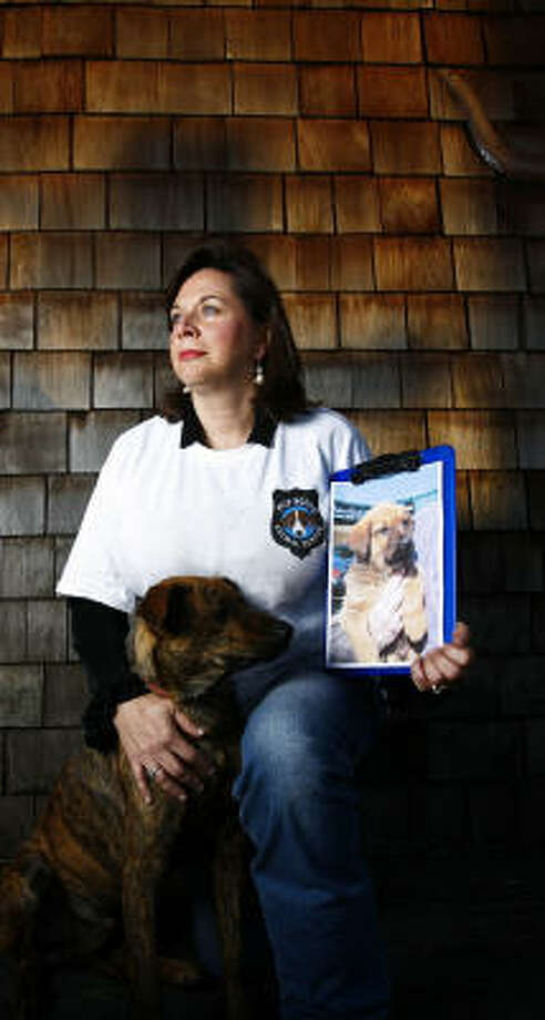 """Judy Jozwiak, with her puppy Roy, said her dog, Albert, received substandard veterinary care from BARC when he was neglected for four hours before being euthanized. """"Roy was like a nurse and always took care of Albert while he was sick and dying,"""" Jozwiak said. Photo: Michael Paulsen, Chronicle"""