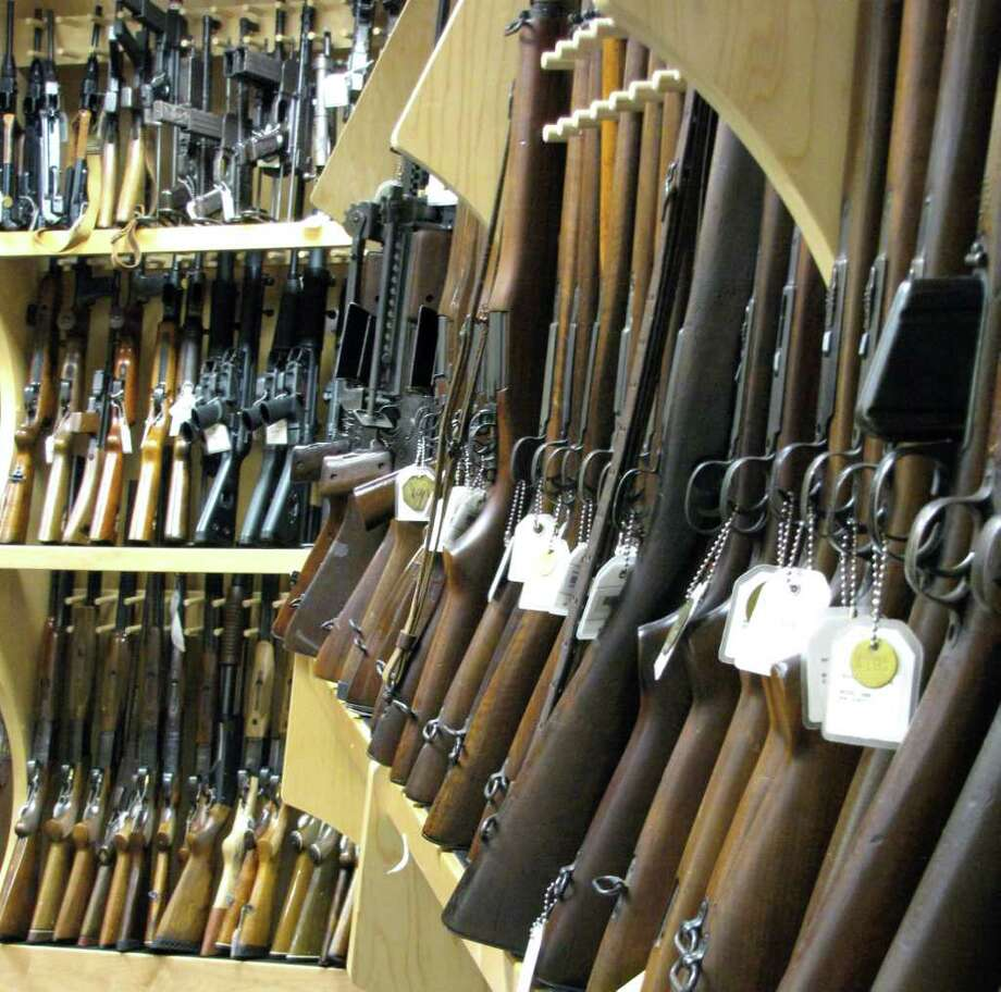 Gun experts at the tracing center set aside some of the firearms most commonly seen in ATF field offices in Texas and, consequently, in crimes along the border.  Photo by Andrea Vasquez