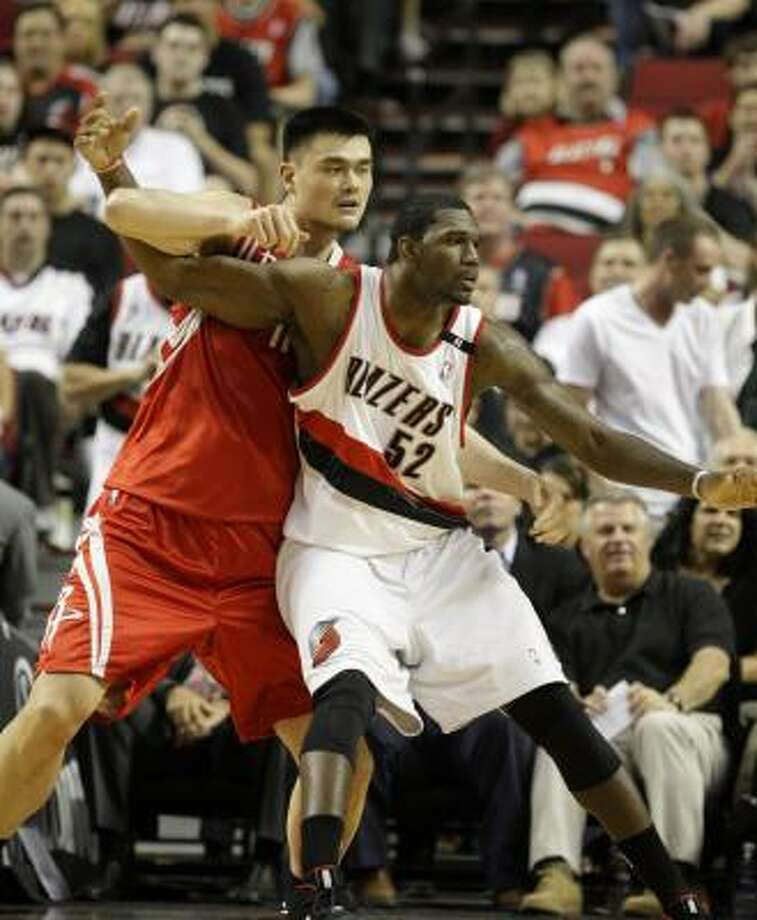 In Tuesday' Game 2, the Blazers used Greg Oden, right, as one of their big bodies to sandwich Yao Ming defensively and make it tough for the Rockets to get their center involved in the offense. It worked. Yao got off just six shots. Photo: Rick Bowmer, AP