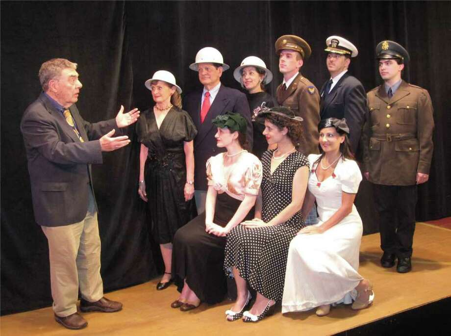 Lester Colodny, left, offers the poignant tune, 'I'll Be Seeing You,' to fellow cast members of 'American Songbook, the Music of World War II,' which opens July 29 in New Canaan. Cast members include, from left, front row, Amanda Goodman, Lisa Dahlstrom and Lauren Nicole Sherwood, and second row, from left, Terry LeBel, Tom Butterworth, Marion Richard, Bill Adams, Daniel Bayer and David Sylvia. Contributed photo/Cindy Ording Photo: Contributed Photo