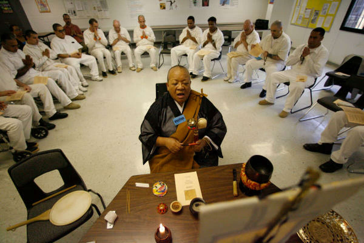 Nichiren Buddhist priest Myokei Caine-Barrett, 58, of Houston leads a group of inmates at the Texas Department of Criminal Justice's Pack Unit near Navasota. Each Friday and the occasional Sunday, Caine-Barrett leads her 21-member congregation in chants and meditation as well as preaching sermons.