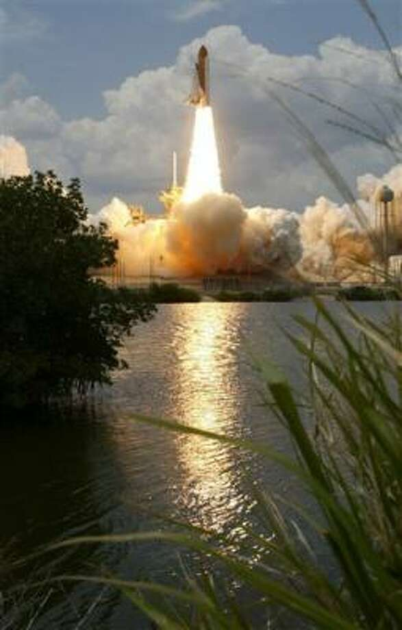 Space shuttle Atlantis lifts off from Kennedy Space Center on Monday. Photo: Associated Press