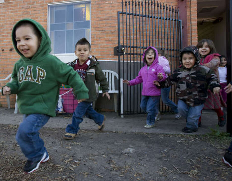 FEWER KIDS: Children head out to the playground at the M.D. Anderson Family YMCA Early Child Development Center in Houston. Some parents are cutting back on day care, and this YMCA facility has lost about 50 percent of its after-school program children. Photo: Johnny Hanson, Chronicle