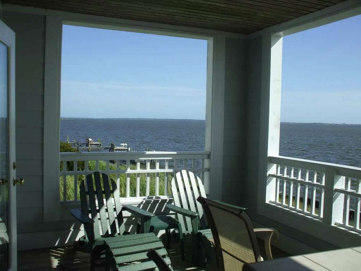A condo at Pirate's Cove in the Outer Banks offers spectacular views of the bay off the back deck. Listen and you can almost hear the sea grass whispering as it rustles in the breeze.