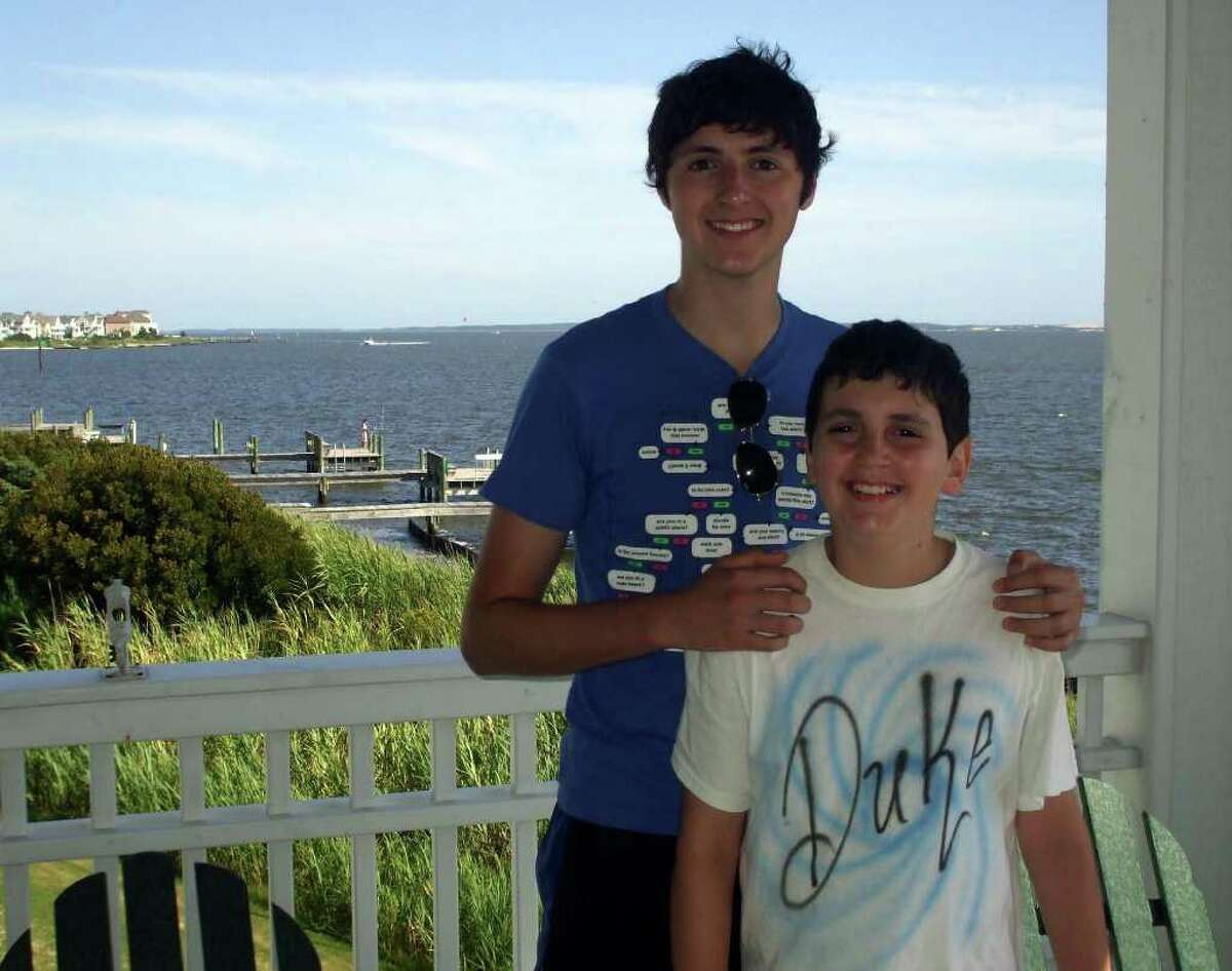 The writer's children, Michael, 19, and Taylor, 11, appease their mom's request to pose for yet another photo. This one is on the deck of a Pirate's Cove condo overlooking the bay in Manteo, in the Outer Banks.