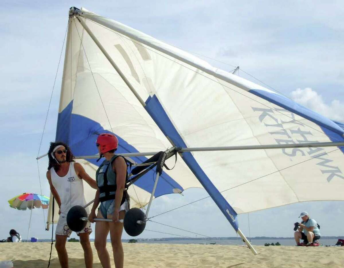 Alexis Marion, left, a hang gliding instructor with Kitty Hawk Kites, gives some last-minute advice to writer Linda Tuccio-Koonz. Kitty Hawk Kites is based on the Outer Banks of North Carolina, and has given lessons to more than 300,000 people from ages 4 to 92.