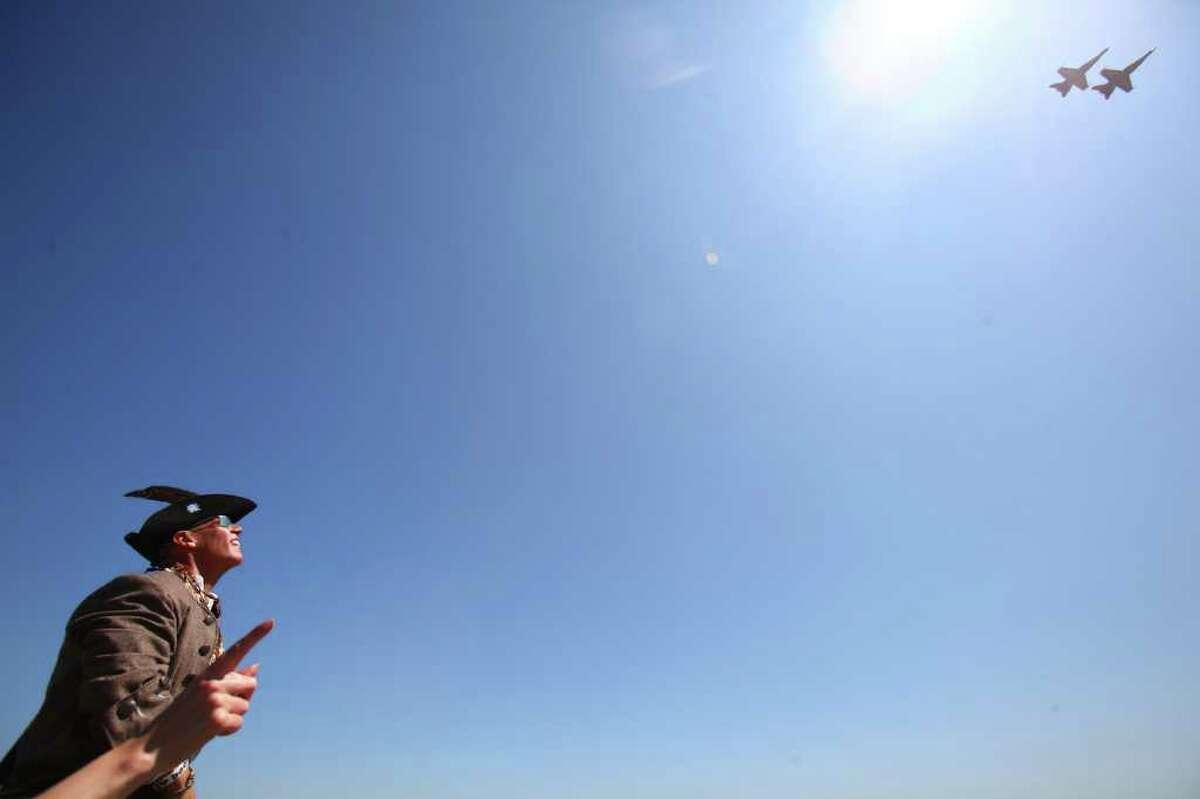 Spectators, including Brian Stambuk, watch the U.S. Navy Blue Angels practice on Thursday over Lake Washington.