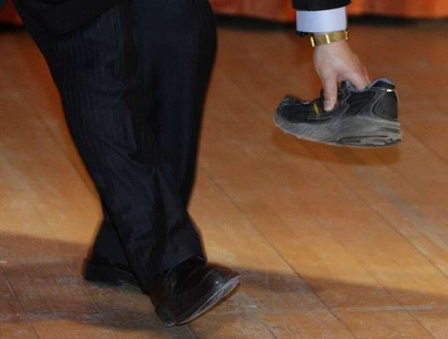 In 2009, then-Chinese premier Wen Jiabao was giving a lecture at the University of Cambridge in the United Kingdom when a 27-year-old German national stood up in the audience and threw his shoe at him. The shoe landed a few feet away from Jiabao. Photo: Darren Staples, AP
