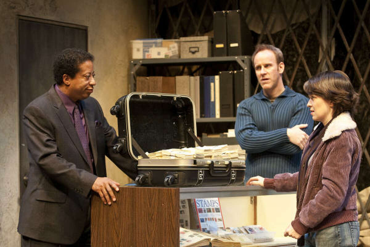 David Rainey, left, as Sterling, Chris Hutchison as Dennis and Elizabeth Bunch as Jackie play a group of people fighting over rare stamps in Mauritius at the Alley Theatre.
