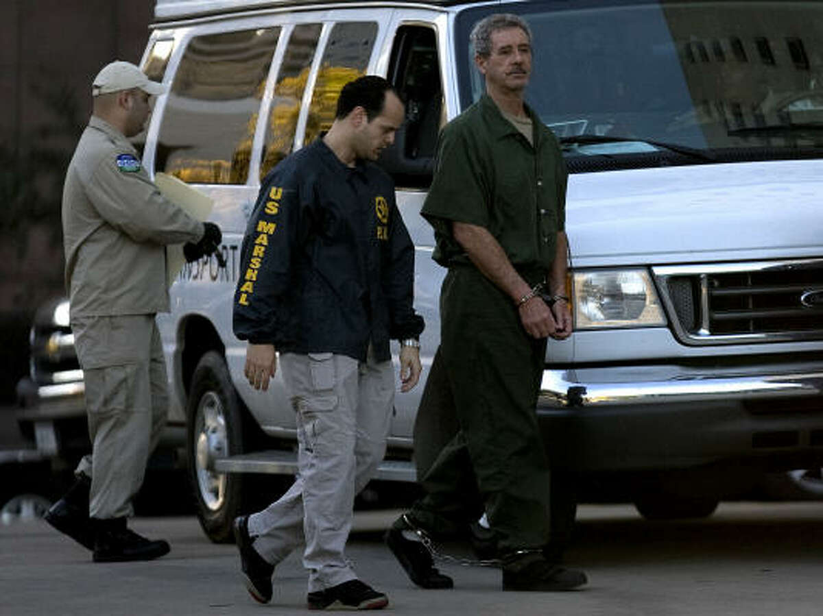 R. Allen Stanford, center, is escorted into the Bob Casey Federal Courthouse for a civil lawsuit hearing Tuesday in Houston.