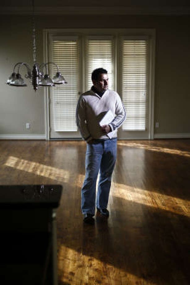 """Jorge Caballero looks at the townhouse he wants to buy. """"I've got a signed contract, and they said basically, 'We don't care,'"""" Caballero said. Photo: Michael Paulsen, Chronicle"""