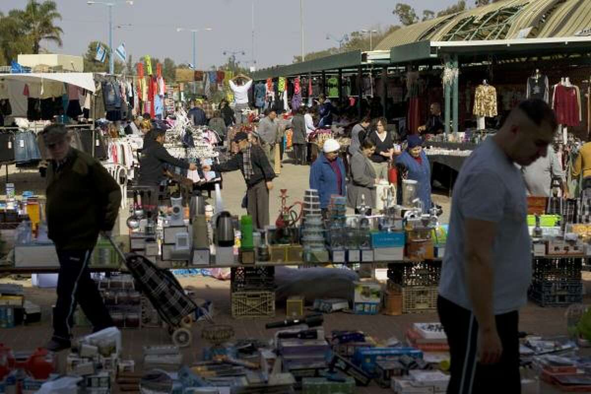 Israelis are seen at the market in the southern Israeli city of Sderot, Sunday. Sderot's open-air market is open and bustling for the first time in a month, thanks to newfound quiet brought by Israel's punishing offensive against Palestinian militants in the Gaza Strip.