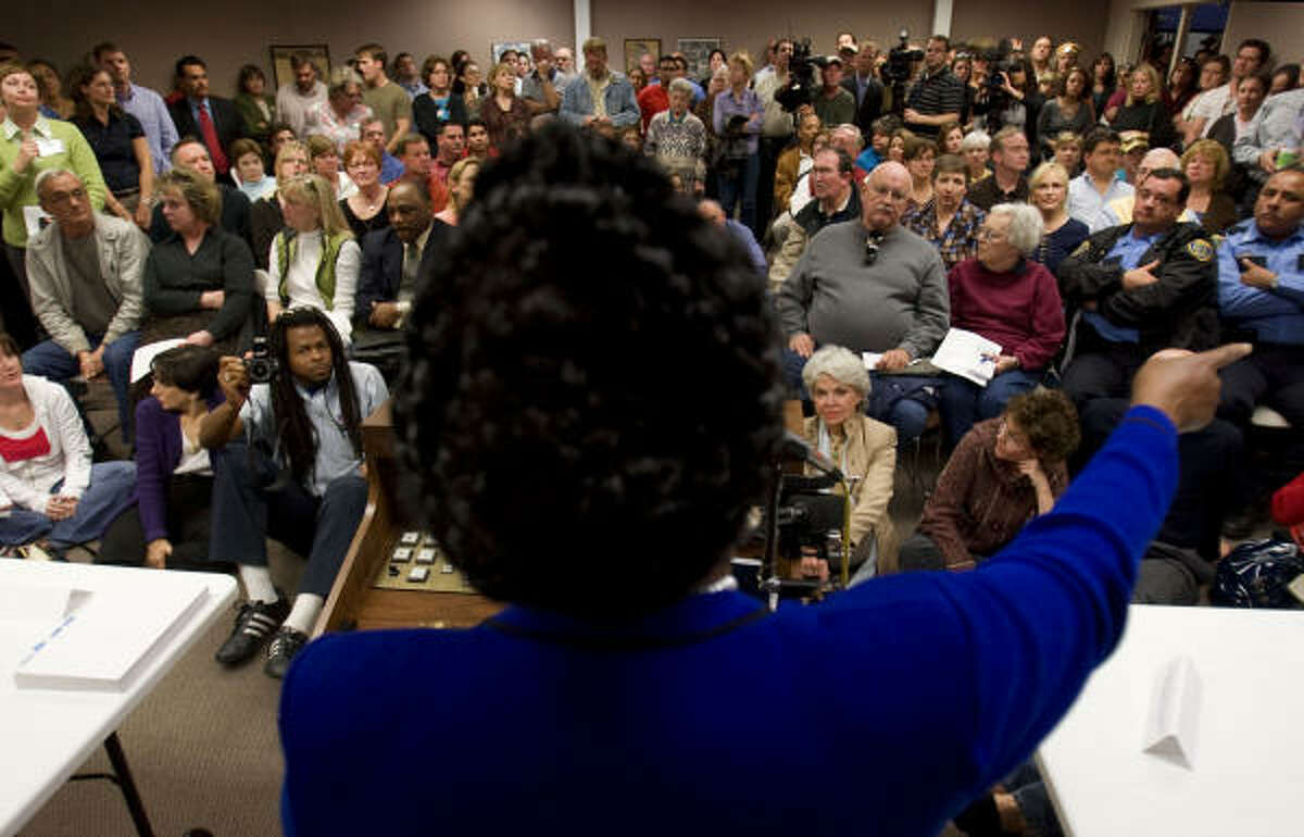 U.S. Rep. Sheila Jackson Lee, D-Houston, hosts a packed crime prevention town hall meeting at the Heights Library on Monday.