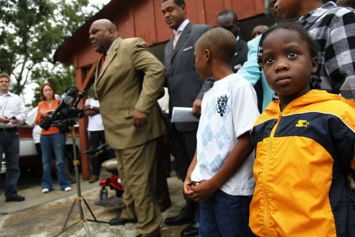 Ruben Holmes, 65, addresses the media during a news conference called Sunday by Houston City Council member Jarvis Johnson, center, to protest HISD's plans.