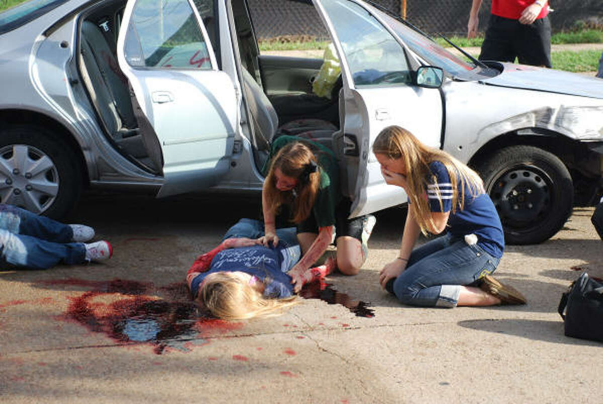 MOURNING A FRIEND: Seniors Daryl Ann White, left, and Lizzie Wild react to the realization that their friend, Samantha Ehlinger, has 'died' during the mock DWI production of Shattered Dreams.