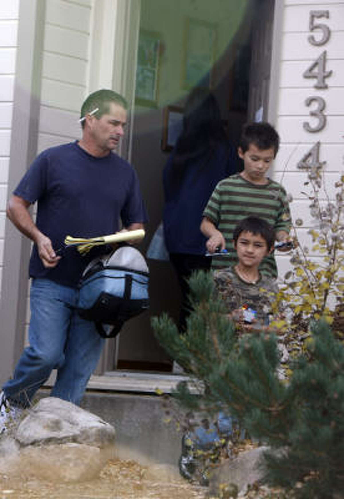 Richard Heene and two of his sons, Ryo, back, and Falcon, leave their Fort Collins, Colo., home early Sunday.
