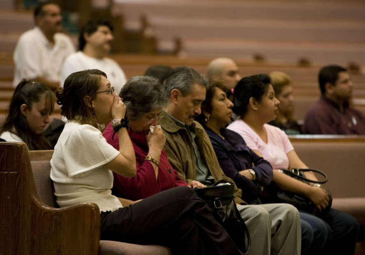 Susana De Jesus' sister Guilly Puente, mother Nina Muñoz, Jose Muñoz, uncle, Martha Del Angel and friend Patricia Zepeda, attend a prayer vigil at the Catholic Charismatic Center on Tuesday.