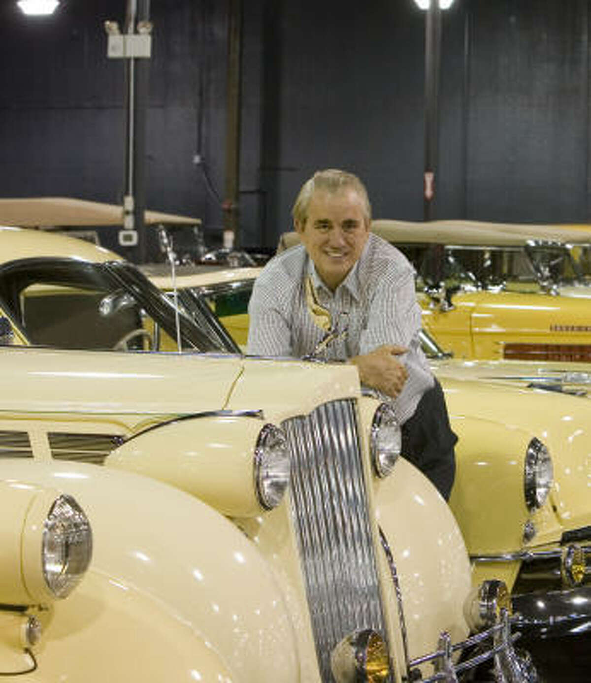 John O'Quinn leans on a 1938 Packard Super-Eight in May 2006. He started his collection in 2003, and it numbered about 800 classic cars at the time of his death in 2009.