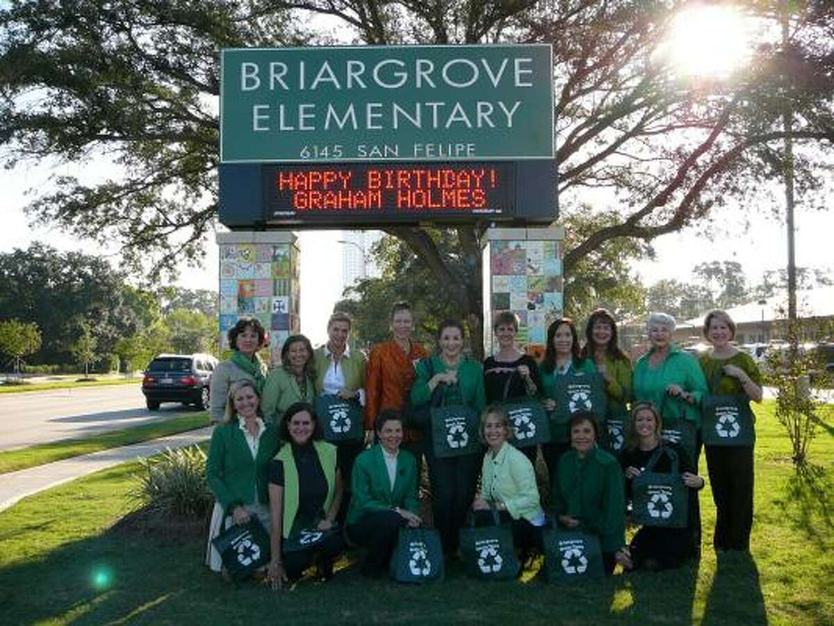 GOING GREEN: Martha Turner and agents display the Briargrove Green Team bags.
