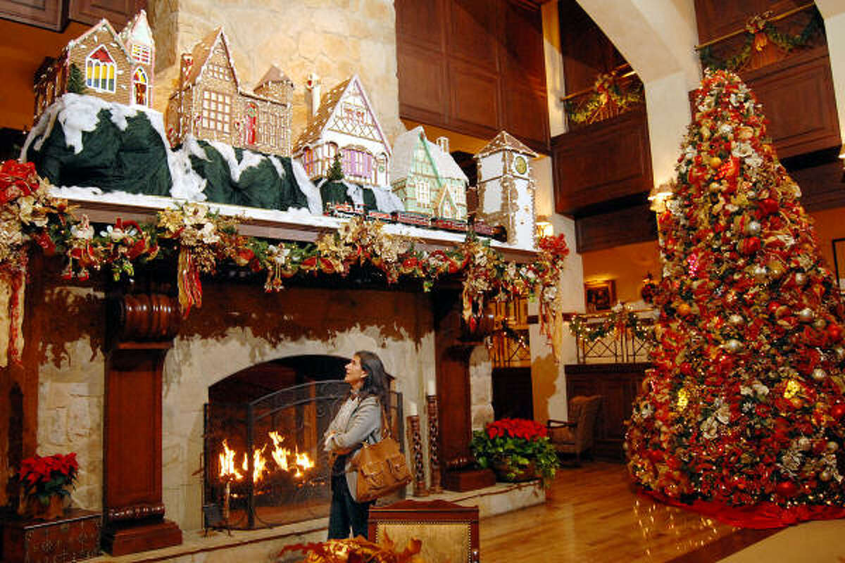 GINGERBREAD WONDER: Teresa Rojas from Spain takes a look at the gingerbread village in the lobby at the Houstonian Hotel on Dec. 3. The village always makes an appearance during the holiday season for guests and visitors to see.