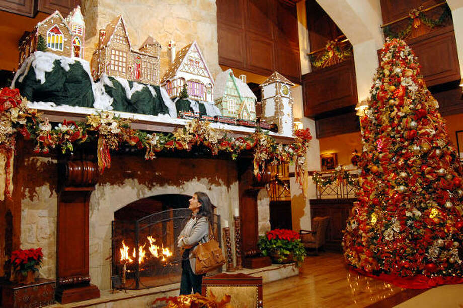 GINGERBREAD WONDER: Teresa Rojas from Spain takes a look at the gingerbread village in the lobby at the Houstonian Hotel on Dec. 3. The village always makes an appearance during the holiday season for guests and visitors to see. Photo: Dave Rossman, For The Chronicle