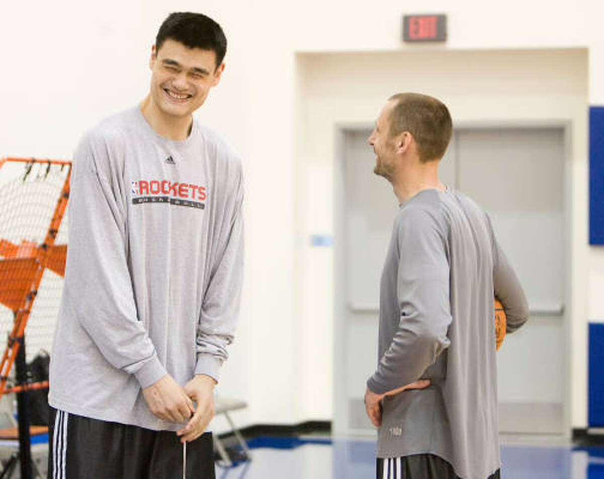 Yao Ming, left, enjoys the pointers from Brent Barry on how to handle the media during Monday's shootaround.