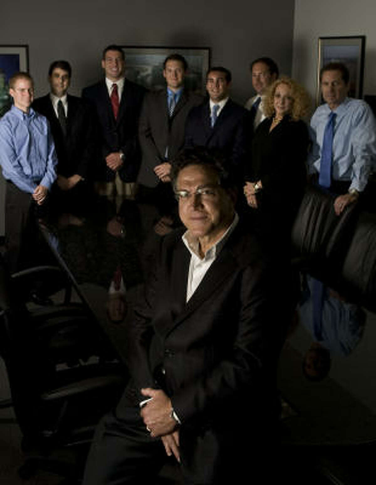 Situs founder Martin Bronstein, foreground, with employees, from left to right, Robert Heckeroth, Maury Bronstein, Will Moss, Ryan Sullivan, John Wall, Andy Uschold, Ginger Simon and Randall Tuller. What started more than 20 years ago as a three-man brokerage firm has grown to 221 employees and offices worldwide.