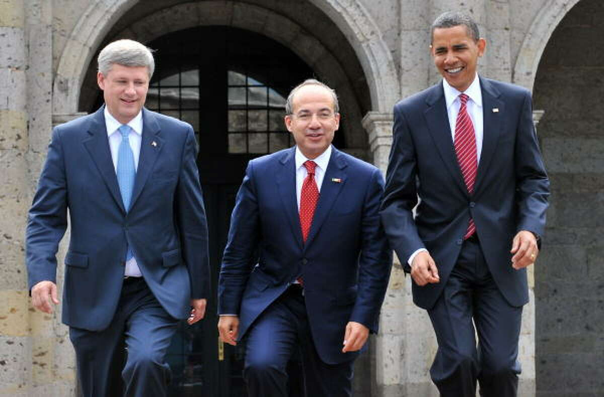 President Barack Obama, with Mexico's Felipe Calderon, center, and Canada's Stephen Harper at the Cabanas Cultural Center, talked with his counterparts about the economy, violent drug cartels and the environment.