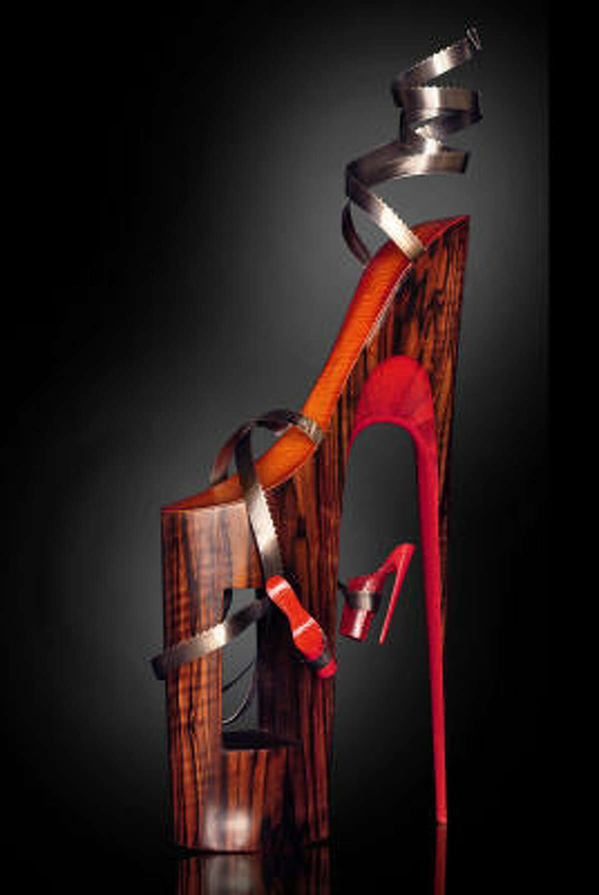Omar Angel Perez's Serpentine Liaison is a 37-inch-tall sculpture of a high heel made of ebony, snake skin, maple and band-saw blades.