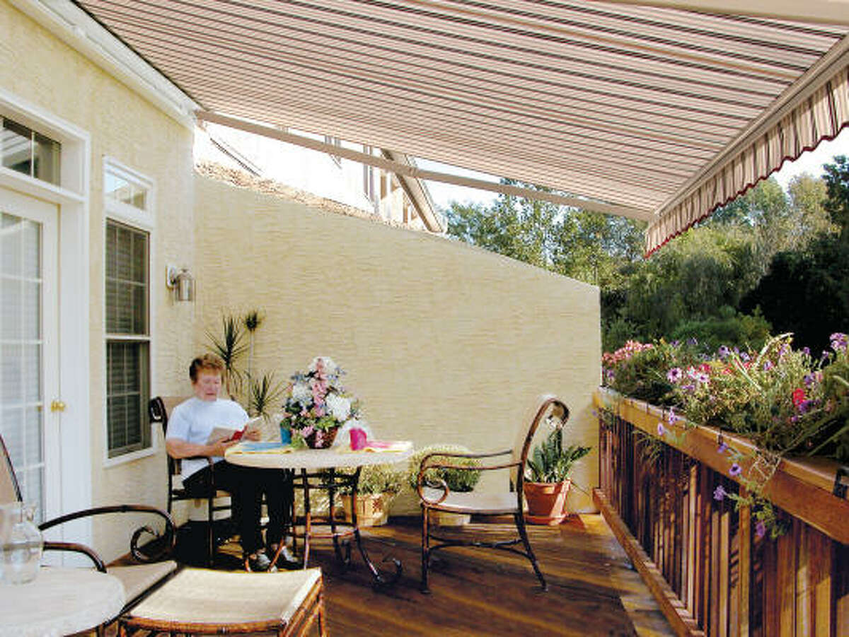 SUN SCREEN: This lateral-arm retractable awning opens to cover entire porch areas.