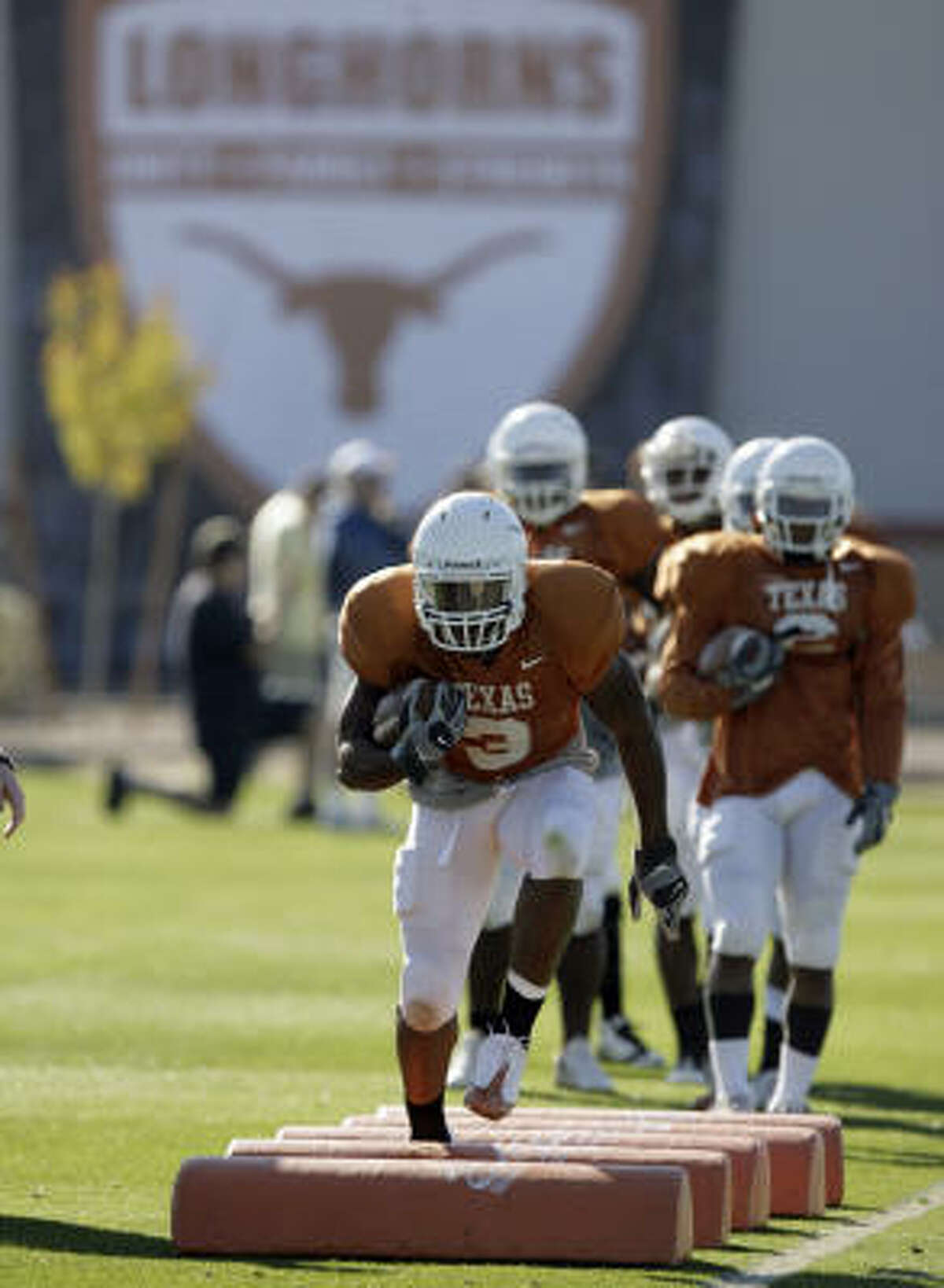 Texas coach Mack Brown has been pleased with the Longhorns' preparations as they try to send seniors like running back Chris Ogbonnaya, front, out winners in their college finale.