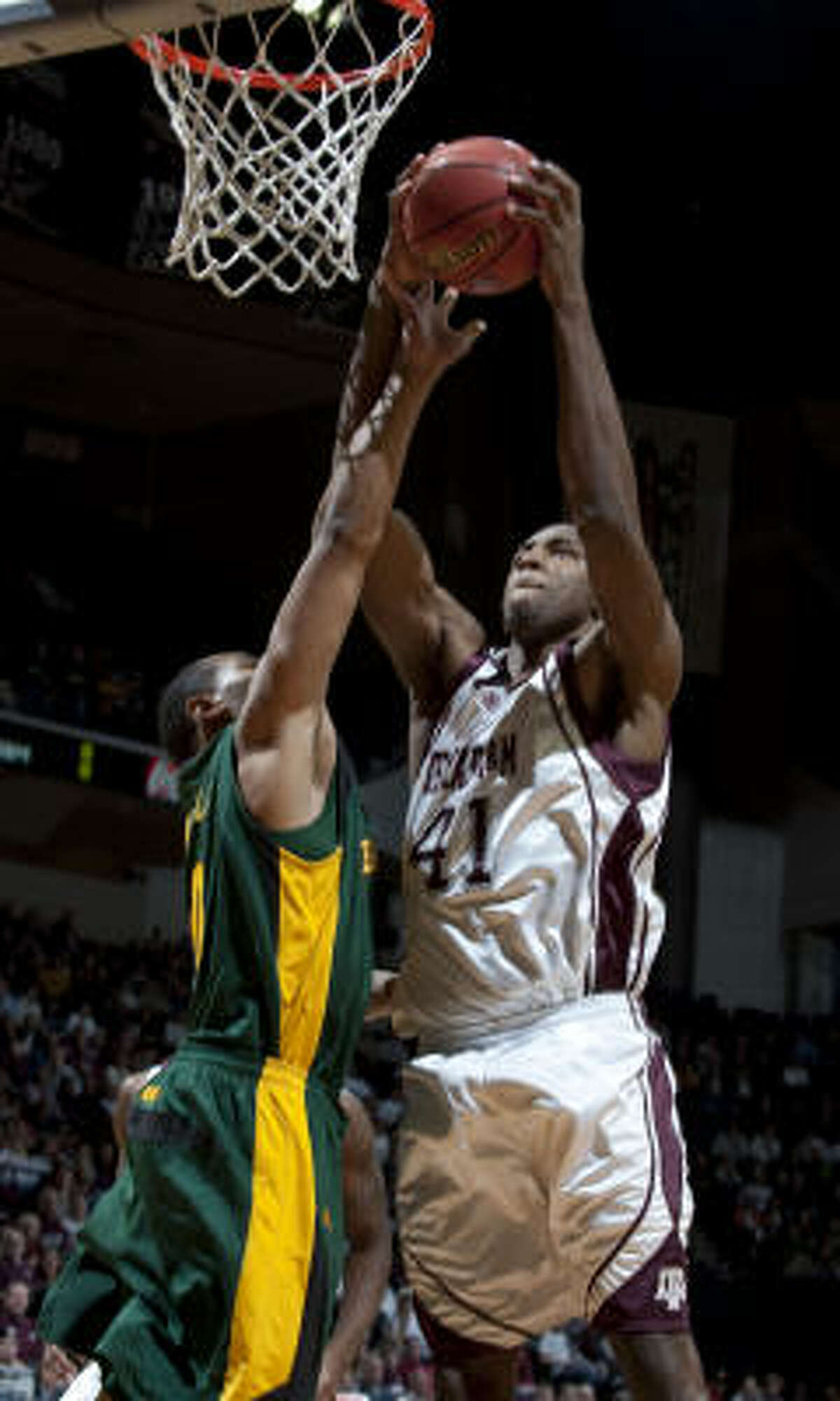 Texas A&M's Chinemelu Elonu, a former Elsik standout, is averaging 11 points and a team-high 8 rebounds per game this season.