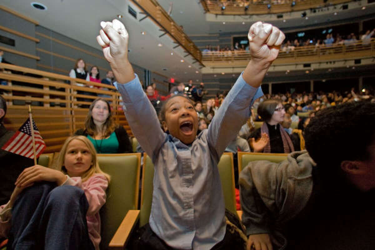 PHILADELPHIA FREEDOM: Aaliyah Johnson, 9, a third-grader at Independence Charter School, was among those cheering while watching the inauguration at the Kimmel Center.