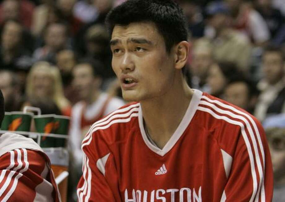 Yao Ming will miss a second straight game after injuring his knee Friday night in Indiana. Photo: Darron Cummings, AP