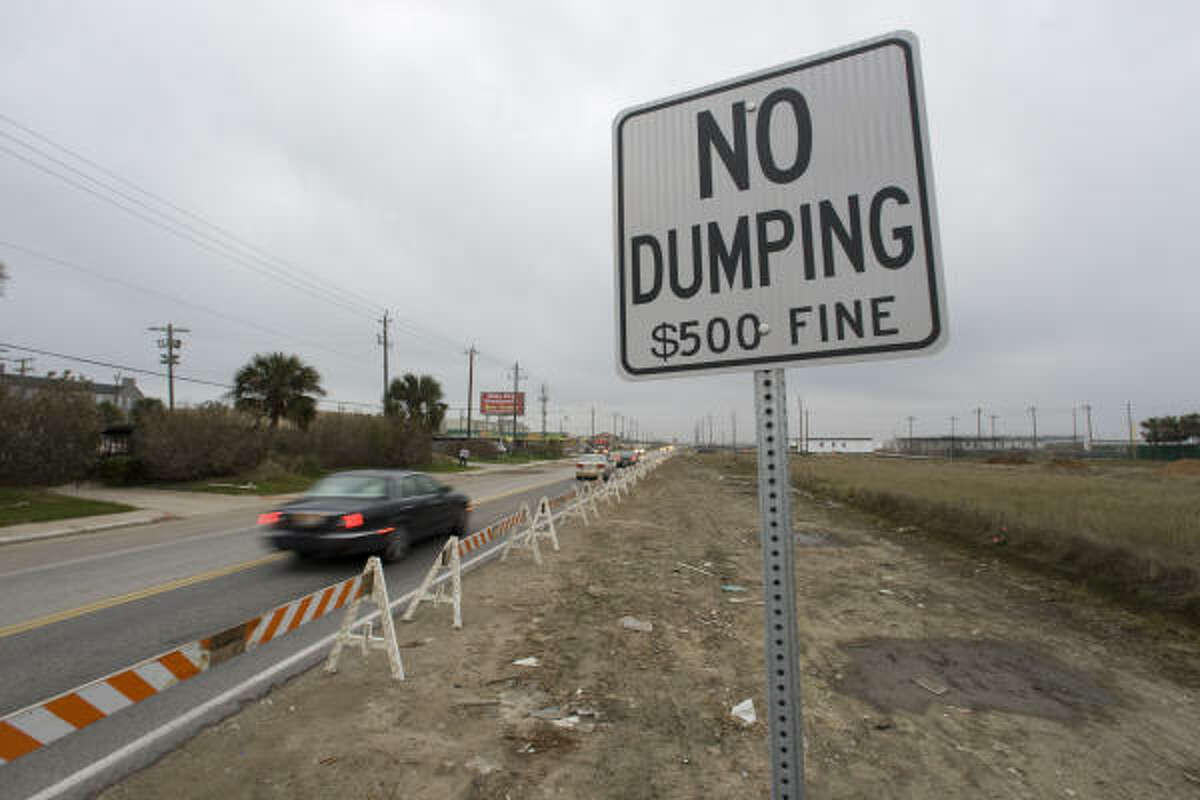 Barricades line Stewart Roach near 83rd Street in Galveston to try to block illegal dumping of hurricane debris.