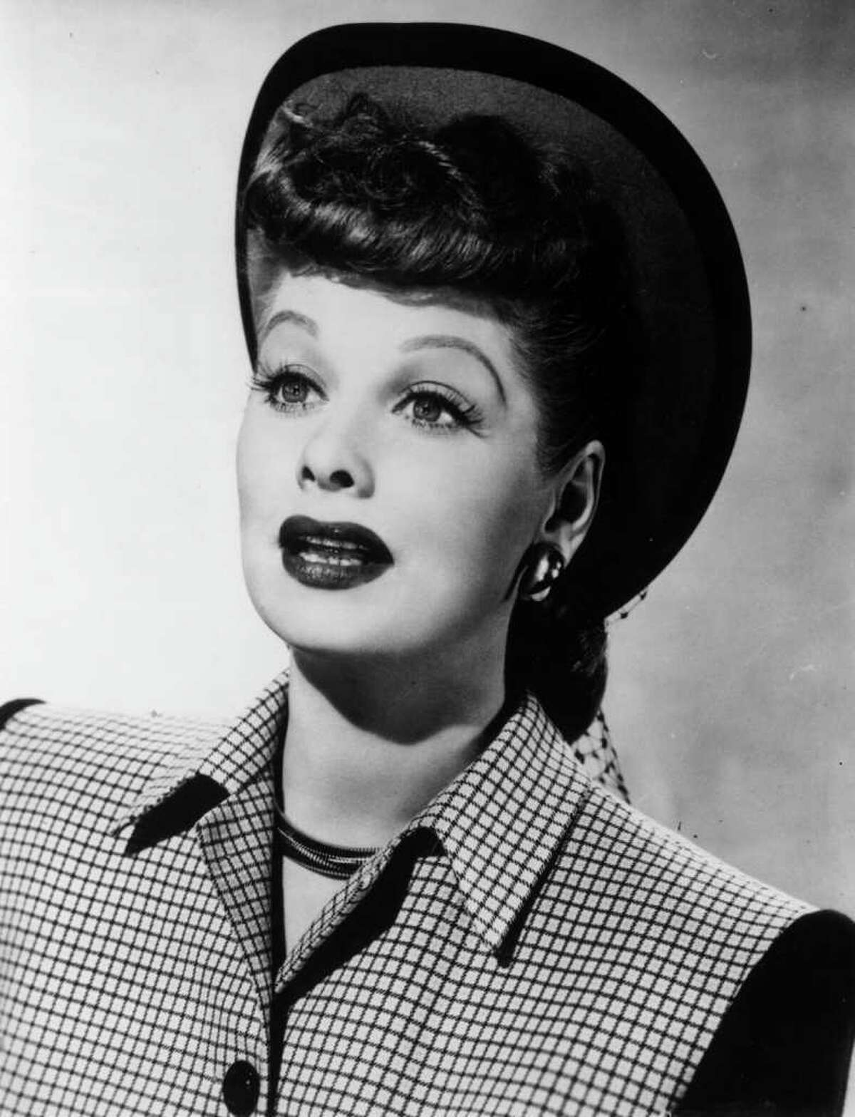 21st August 1947: American comic actress Lucille Ball (1910 - 1989) wearing an autumn hat called the 'Career Woman Hat' in bright green felt with a deep brown border, worn off the face to complement Ms Ball's coiled hairstyle, which has curls over the forehead and a reciprocal coil under the back brim. (Photo by Hulton Archive/Getty Images)