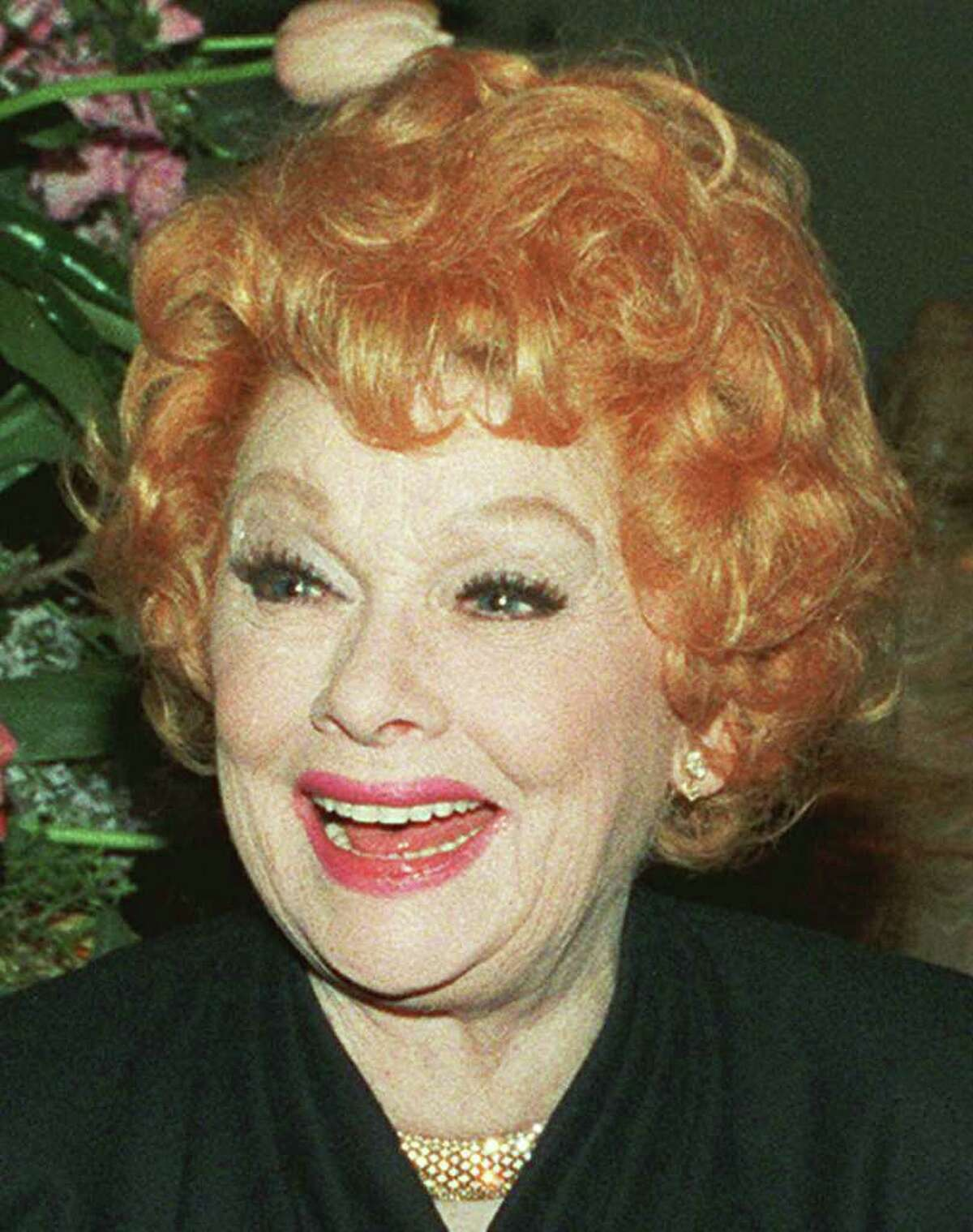 FILE---Actress Lucille Ball shown here in this March 4, 1987 file photo. Ball was nominated by the American Film Institute as one of the 50 greatest American film legends of the 20th century, Tuesday, Jan. 12, 1999. (AP Photo/File/Alison Wise/FILE) HOUCHRON CAPTION (11/04/1999)(11/14/2000)(03/20/2002): Ball.