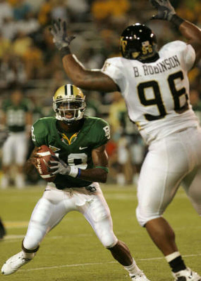 Baylor quarterback Robert Griffin did not run track this spring to concentrate on football. Photo: Donna McWilliam, AP