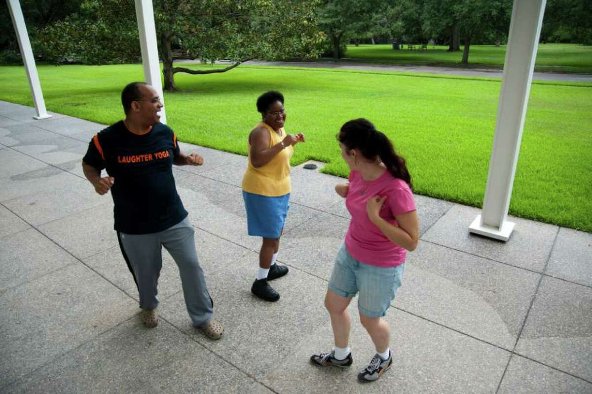 HOUSTON- Elanore Crystal Cornell, center, participates in laughter yoga with Stephen Findley and Lainie Diamond in Menil Park July 18, 2011.