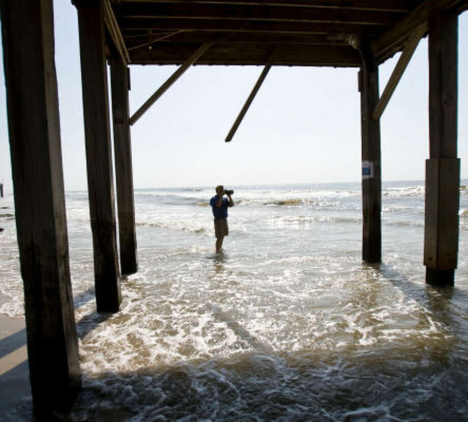 Ellis Pickett, a surfer and chairman of the Surfrider Foundation's Upper Texas Coast Chapter, sees evidence with every visit to Surfside Beach of the shrinking sand and its effect on homes. He fears Surfside will disappear like Sargent Beach did. Photo: Nick De La Torre, Chronicle