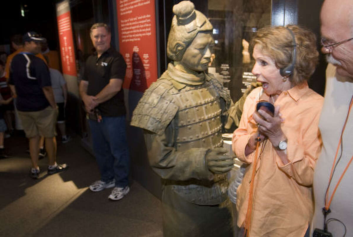 Dressed as a terra cotta warrior, Jarry Zheng, a performance artist from Taiwan, roams among visitors to the Terra Cotta Warriors: Guardians of China's First Emperor.