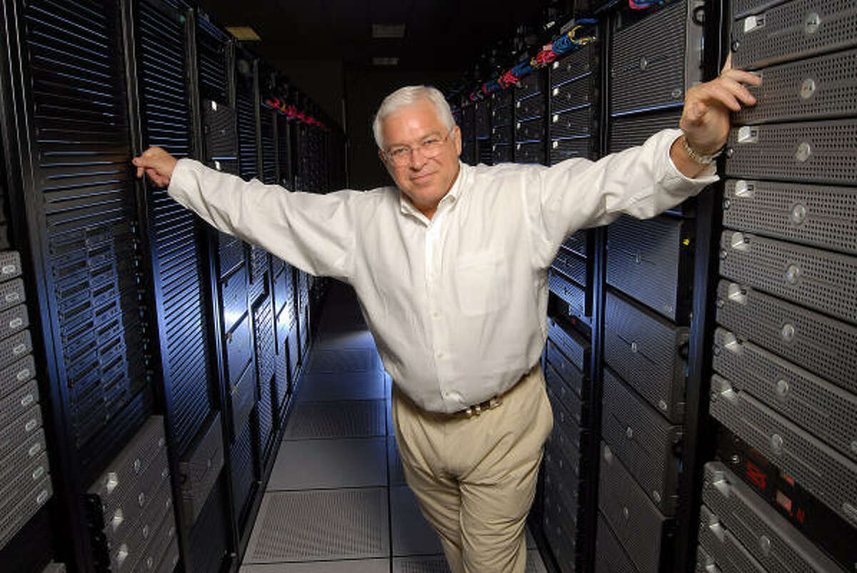 Doug Erwin, CEO of The Planet, looks over the company's data center. He had to meld different corporate cultures.